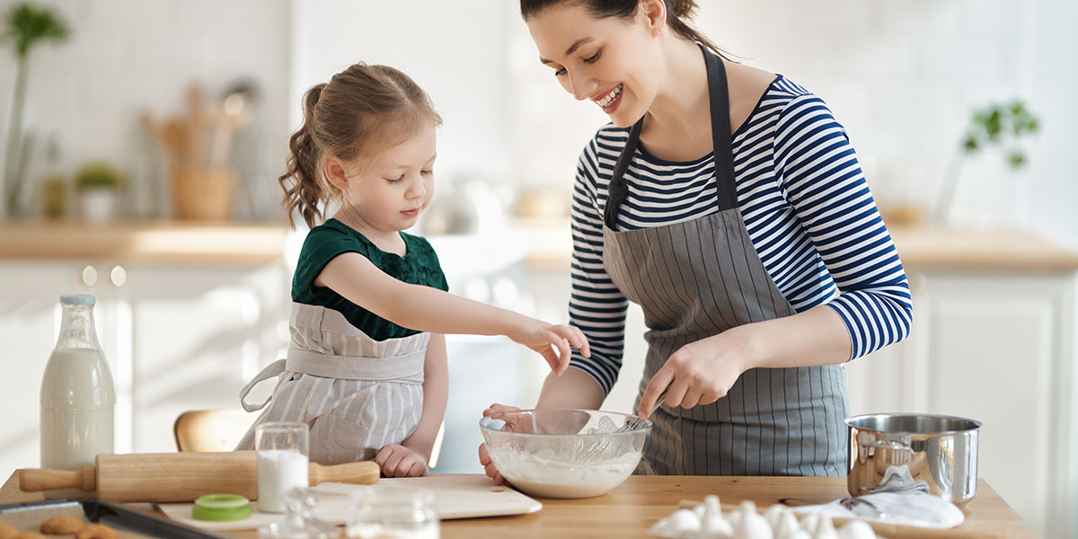 Child cooking with mom can be fun in French